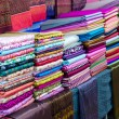 Pile of colorful  fabrics — Stock Photo