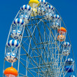 Foto Stock: Ferris Wheel on Blue Sky