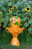 Outdoor orange Fountain in the Garden sunflowers — Stock Photo
