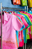 Colors clothing on hangers at the show — Stock Photo