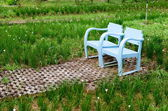 Blue wooden lawn chairs — Stock Photo