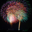 An image of exploding fireworks at night — Stock Photo