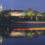 Poland, Krakow, Wawel Royal Castle, Lights of a Passing Boat — Stock Photo #27755675