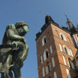 "Stock Photo: Poland, Kraków, ""Student"" Statue and Towers of st Mary's Church"