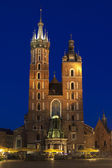 Poland, Krakow, Mariacki Church Facade Lit up at Dusk — Stock Photo
