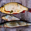 Three fish on table — Stock Photo #29328037