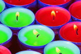 Red and green tealights in closeup — Stok fotoğraf