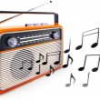 Portable radio and music notes — Stock Photo