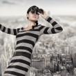 Woman stands on top of a ladder using a spyglass — Stock Photo #33305393