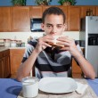 Teenager eating Peanut Butter and Jelly Sandwich — Stock Photo
