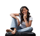Happy black woman in jeans and white t-shirt isolated on white — Stock Photo