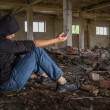 Drug Addict getting High in an Abandoned Building Dramatic — Stock Photo