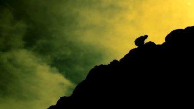 Man Climbing Rocks Lifting Hands in Worship Pose Color Enhanced — Stock Video
