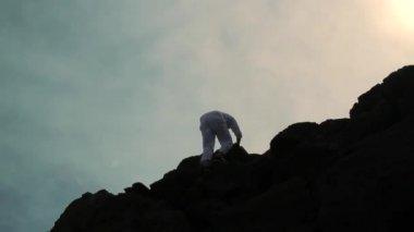 Climber Reaching Top of a Mountain Raising Hands Success — Stock Video