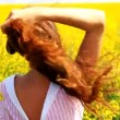 Beautiful Young Woman Standing Yellow Field Caressing Hair Slow — Stock Video #29730501