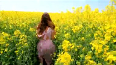 Young Woman in Vintage Dress Running Field Touching Flowers HD — Stock Video