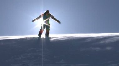 Young Man in a Worship Pose on Top of a Mountain Winter Nature — Wideo stockowe