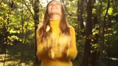 Woman Playing with Autumn leaves — Stock Video