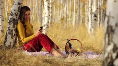 Female Using cell phone at Picnic — Stock Video