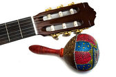 Maracas with acoustic guitar isolated on white — Stock Photo