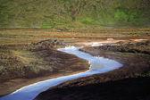 Milky blue sulphur stream — Stock Photo
