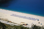 Sunbeds on Myrtos Beach — Stock Photo