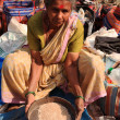 Woman sifting in a street market India — Stock Photo
