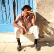 Cuban man with a fat Cuban cigar — Stock Photo #30839311