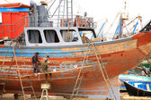 Workers repairing a boat — Stock Photo