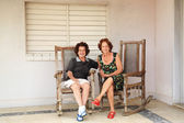 Two ladies sat on the porch — Stock Photo