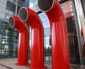Tre röda luftventiler — Stockfoto