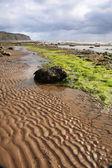 Sand patterns on Robin Hoods Bay beach — Stock Photo