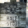 Stock Photo: Old wooden halt sign, Auschwitz