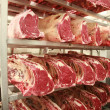 Cuts of beef on shelves in an abattoir — Stock Photo