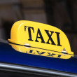 Yellow taxi sign Cuba — Stock Photo