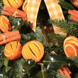 Christmas wreath of oranges and cinnamon — Stock Photo
