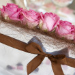 Pink roses on the wedding table — Stock Photo #32369855
