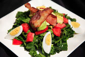 Spinach and bacon salad — Stock Photo