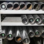 Three rows of metal tubes — Stock Photo