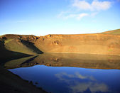 Reflection in volcano crater — 图库照片