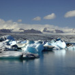 Stock Photo: Panoramic view over hundreds of icebergs