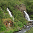 House by the waterfall — Stock Photo
