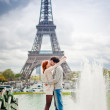Loving couple near the Eiffel Tower in Paris — Stock Photo #27785285