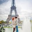 Loving couple near the Eiffel Tower in Paris — Stock Photo