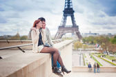 Loving couple near the Eiffel Tower in Paris — Stock Photo