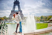 Loving couple kissing near the Eiffel Tower in Paris — ストック写真