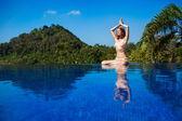 Meditating. Woman doing yoga — Стоковое фото