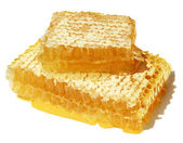 Honeycomb closeup with drops of fresh honey. — Foto de Stock