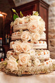 Wedding cake with roses — Stock Photo