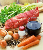Meat with vegetables, spices, and red wine, ready to cooking. — Stock Photo